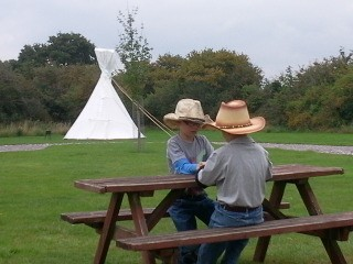 glamping tipi with children playing