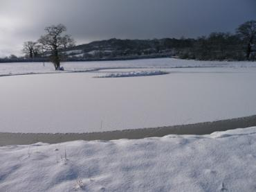 Dorset Country Holidays fishing lake in snow