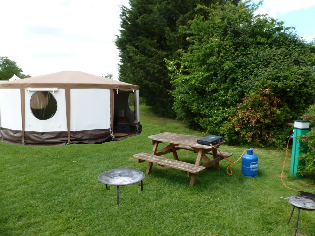 Dorset Stargazer Yurt glamping holiday. Dorset Country Holidays Yurt Glamping Stargazer Picnic Bench Electric Gas Fire Pit BBQ Exterior of Yurt Glamping